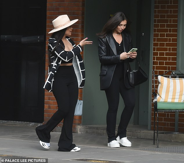Occupied: Francesca was seen using her mobile phone at one point on their stroll