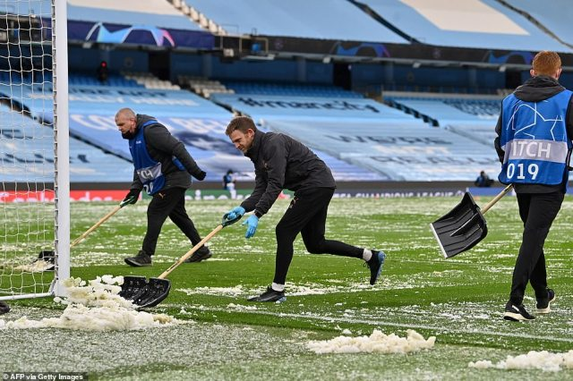 Groundstaff at Manchester City's Etihad Stadium were seen sweeping up ice off the pitch after a hailstorm before the UEFA Champions League Semi Final second leg against PSG