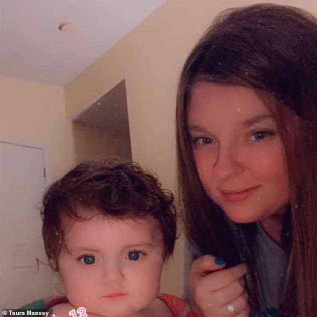 Taura Helsel started feeding her Taco Bell meal to one year-old daughter Olivia, pictured, and says she was sickened to discover a damp cigarette stuck to the bottom of it