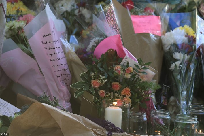 Lit candles and notes were among items left in tribute following the death of Julia last week