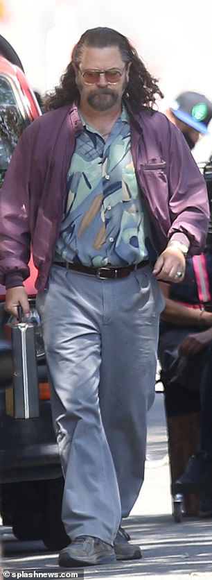 Co-star: Actor Nick Offerman, who also wore a mullet, colorful top and purple jacket, was also on set.