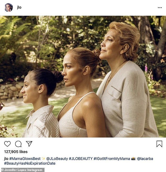 'Mama shines better': Jennifer Lopez took to her Instagram on Tuesday to share a beautiful photo of herself from three generations flanked between her mother Guadalupe Rodriguez, 75, and her 13-year-old daughter, Emme