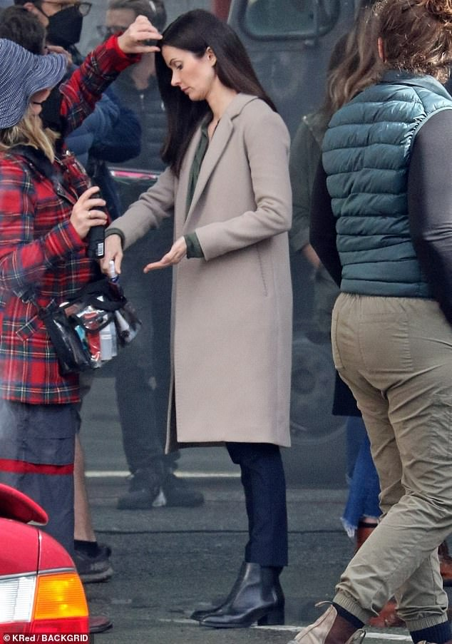 Preparation: Bitsie (real name Elizabeth) was seen getting last minute hair and makeup touch ups in a beige trench coat and jeans with an olive colored blouse