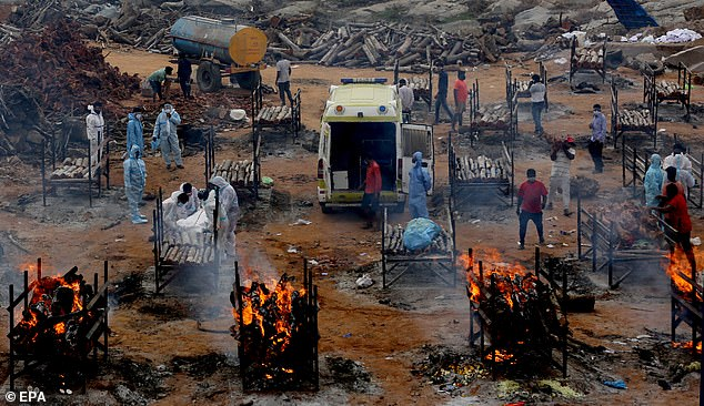 Mass cremations have been held in India for the victims of Covid-19 as the country struggles under huge numbers of the virus