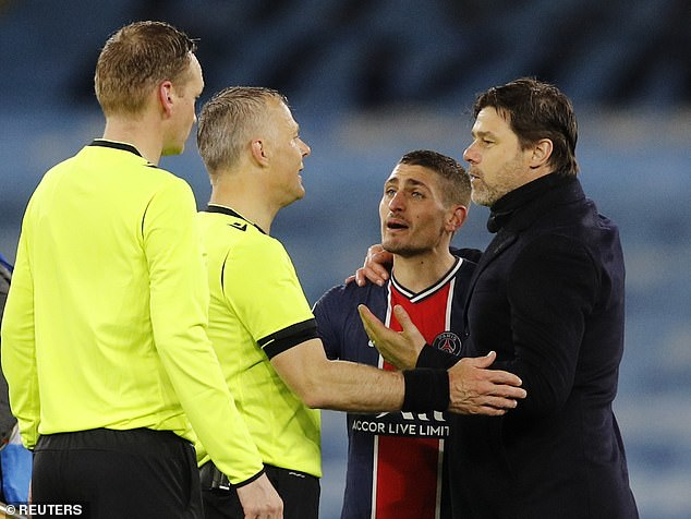 Marco Verratti (second right) argues with referee Bjorn Kuipers (second left) after the match