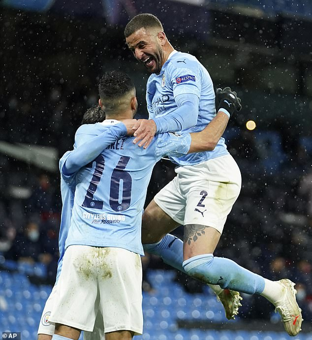 Kyle Walker (right) leaps in celebration after Mahrez made it 2-0 to Manchester City