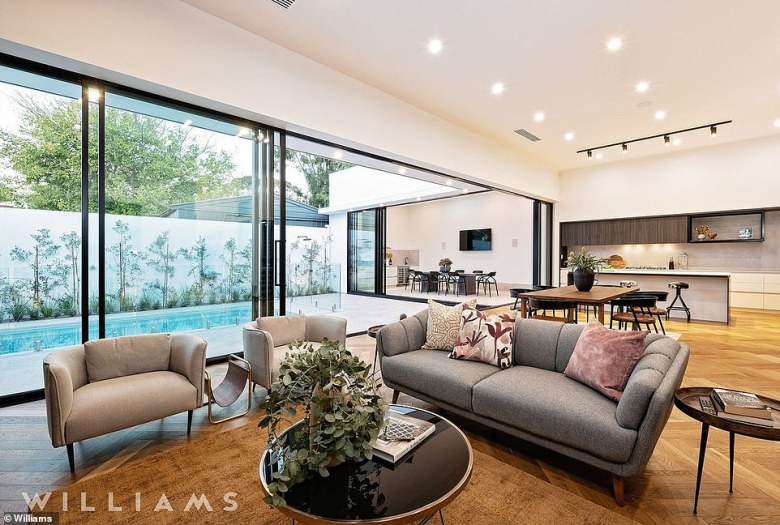 The four-bedroom house is described as a 'remarkable triumph of design' that is 'truly out of this world'