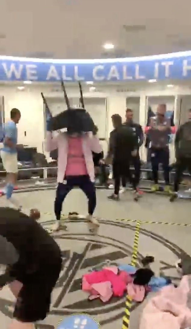After celebrating on the pitch, City continued in the changing rooms as they sang and danced