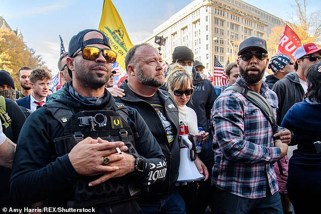 A group of vocal Chinese-Americans support Proud Boys and its leader, Enrique Tarrio, as well as conspiracy theories Alex Jones because they view them as protecting America from a possible takeover by Black Lives Matter and Antifa. Tarrio and Jones are seen left and second from left in Washington, DC on November 14
