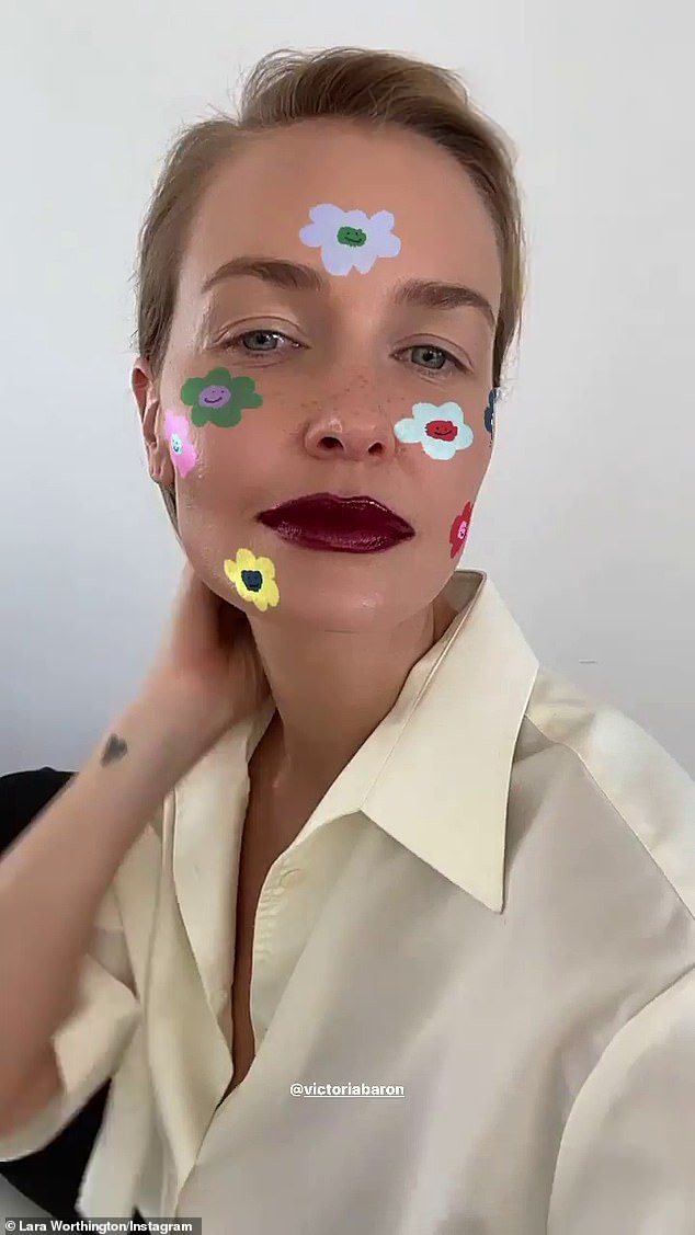 Vampy!  Lara Bingle gave fans a behind-the-scenes look at a photoshoot on Tuesday.  The 33-year-old showed off her edgy new look in the makeup chair on her Instagram Stories