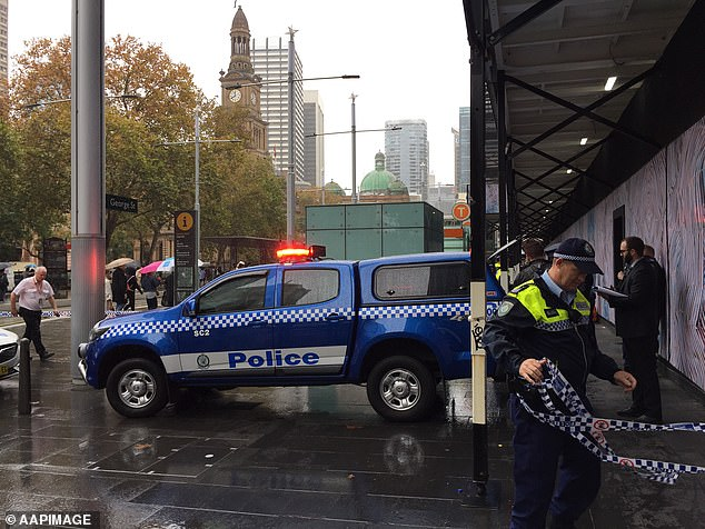Police are pictured outside an entrance to Town Hall train station on Wednesday morning