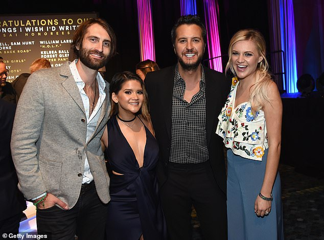 Pals: In reality, Bryan and his wife have been happily married for 14 years, have two kids and adopted his nephew Til and nieces Kris and Jordan after the sudden death of Bryan's brother-in-law in 2014 (the couples seen together in 2017)