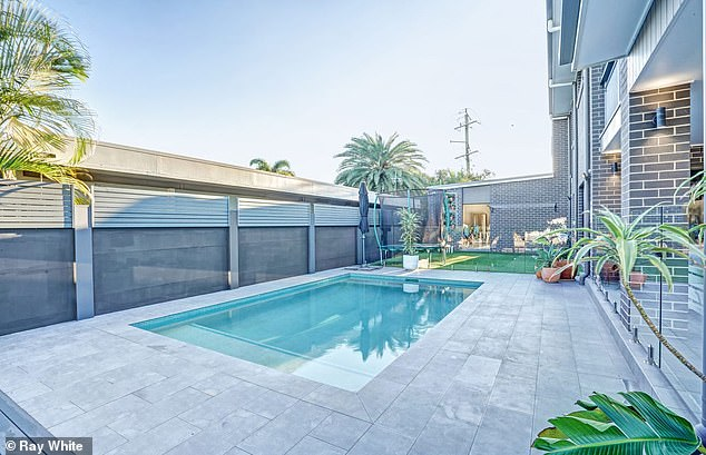 An entertainer's delight: The home, which is being presented by sales and marketing consultant Ronnie Jackson of Ray White Mermaid Beach, is perfect for outdoor entertaining and has a gorgeous back deck overlooking the water