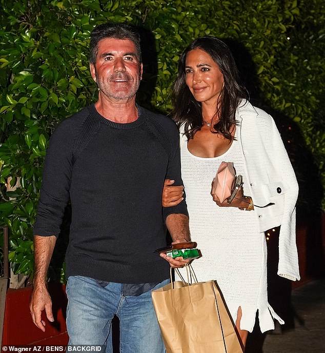 Dinner date: Simon Cowell, 61, leaves the famous Giorgio Baldi restaurant with his partner, eight, Lauren Silverman, 43, as they warm up after a dinner