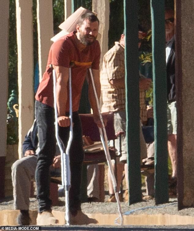 Hot and bothered! Jamie appeared strained as he filmed under the sun