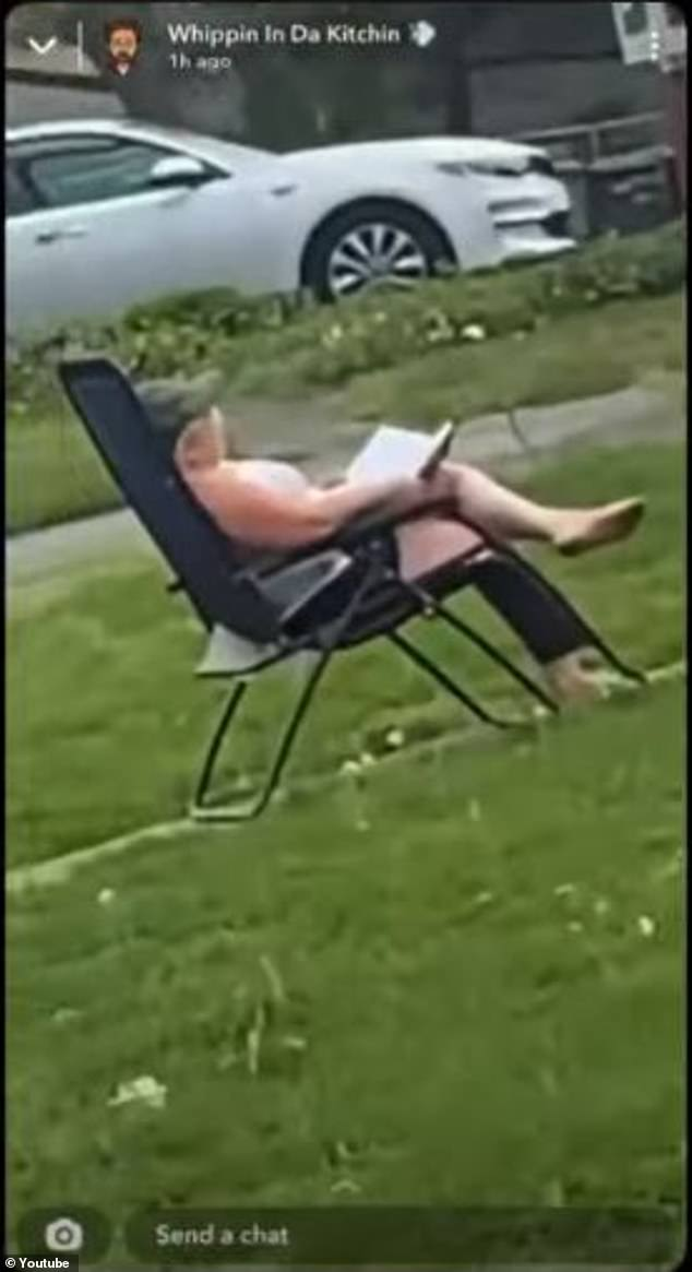 Metwally was pictured sitting in a lawn chair with a book in hand while watching the blaze