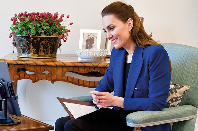Working from home: Kate Middleton, 39, interviewed community Nurse Midwife Harriet Nayiga for the latest edition of industry publication Nursing Times