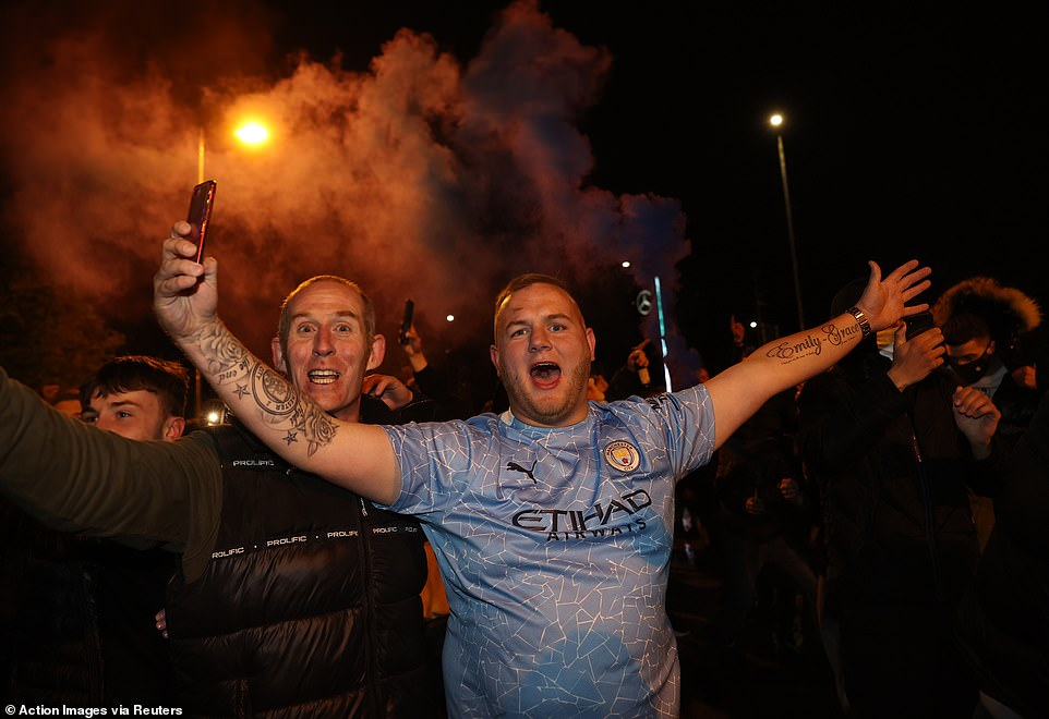 Manchester City fans celebrate their team's victory over Paris Saint-Germain in the Champions League on Tuesday night