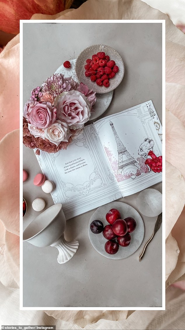 Refined:A third image features the children's book Claris: The Chicest Mouse in Paris, alongside decadent macarons in different flavours, alongside tasty raspberries