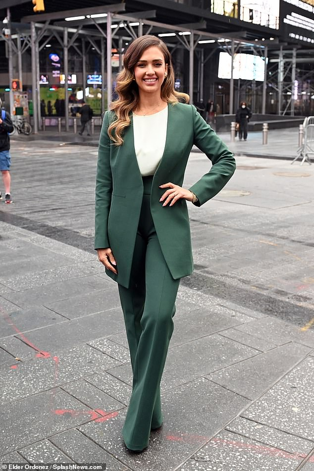 Power moves: Jessica Alba simply shined in an emerald green suit to ring the Nasdaq opening bell on Wednesday morning in New York City