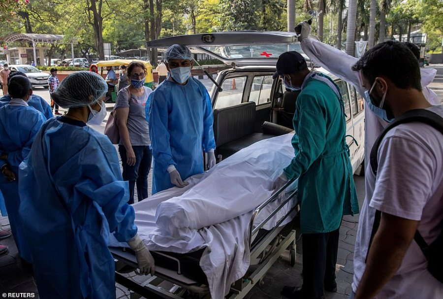 The body ofKaruna Vadhera, 74, is taken from a hospital in Delhi to a crematorium to be burned, as data showed India accounted for one in four global virus deaths in the last week