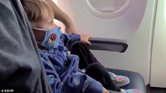 The Scott family was buckled in for their five-hour flight from Colorado to Florida when they were told to de-board
