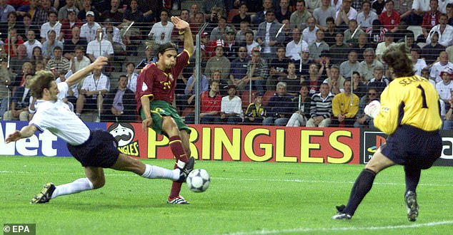 Nuno Gomes completed Portugal's turnaround as he fires past Tony Adams and David Seaman