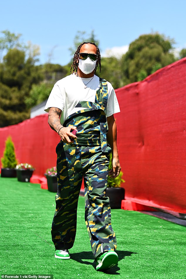Quirky: Lewis Hamilton stepped out in stylish green camouflage overalls on Thursday ahead of the Spanish Grand Prix this weekend