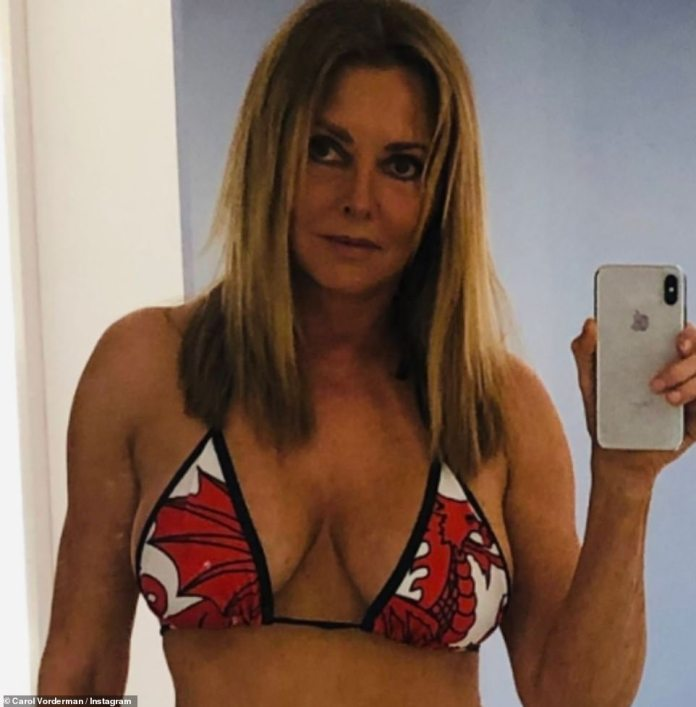 Goodness!  The tv personality has been on a streak littered with bikini snaps on her social media and last month Carol shared a racy snap in a red dragon bikini in 2019.