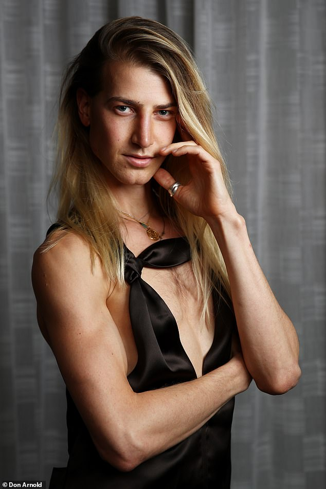 Partnership:The androgynous actor, 26, showed off his chest in a feminine plunging top