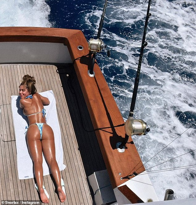 Getting tan:When laying tummy down on a yacht she cheekily said, 'Anyone interested in the catch of the day?'