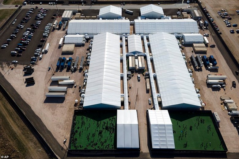 "'All they're doing is, they're moving kids from one tent to the other tent and saying: ""Oh, they're not in the Border Patrol (custody). But they're right next door,""' said Rep. Henry Cuellar (D-Tex.). The administration released images showing a sharp decrease in crowding at the Donna, Texas facility pictured above"