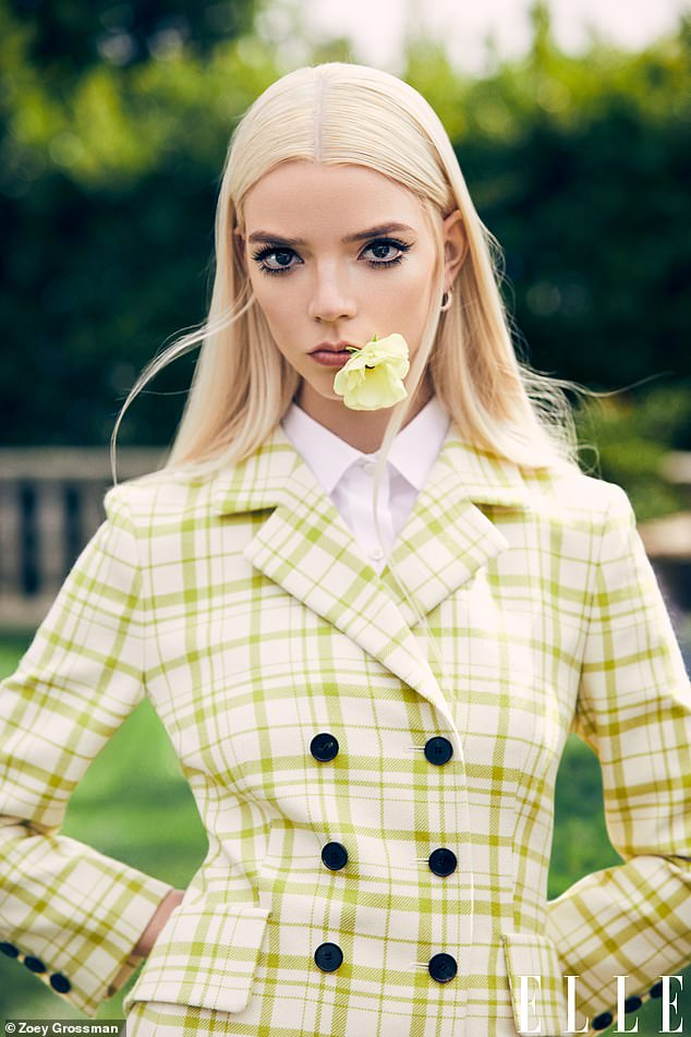 Sophisticated:A different look saw Anya ooze sophistication in a lime green chequered suit jacket with a crisp white shirt underneath