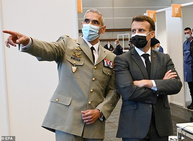 On Tuesday French maritime minister Annick Girardin said Paris would cut off electricity to Jersey – which gets 95 per cent of its power supply from France – if the dispute was not resolved. Pictured: President Macron with a French military leader