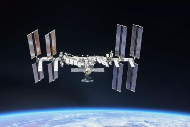 Starry-eyed: The band delivered an electrifying performance of their new song, Higher Power, and beamed the recording to the aerospace engineer, 43, onboard the International Space Station (pictured)