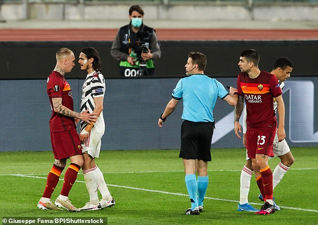 Edinson Cavani jumped-in to defend his team-mate Mason Greenwood from Roma defenders