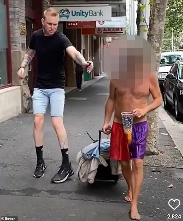 In a since-deleted video the internet personality is seen walking towards a homeless man armed with a green spray bottle