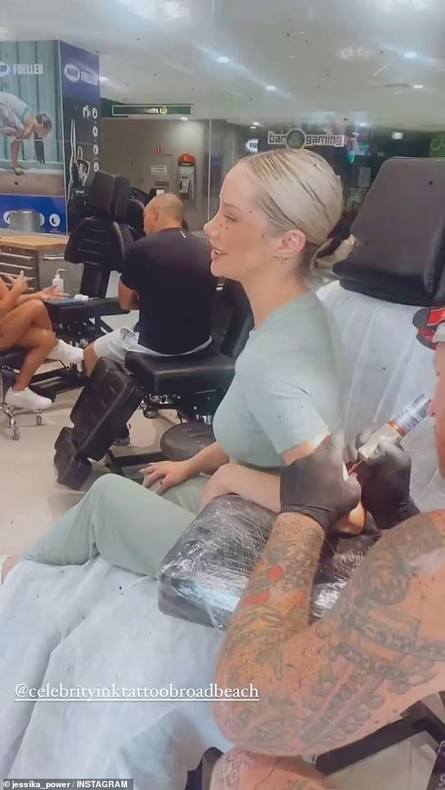 Getting inked: In a series of videos posted to Instagram on Friday, the 29-year-old former Married At First Sight star was spotted visiting a Gold Coast tattoo parlour