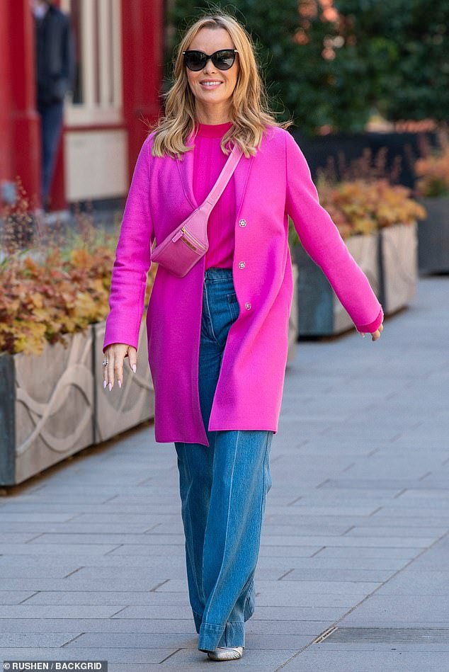 Here she is:The presenter commanded attention in her eye-catching ensemble, which included a wide-ribbed high-neck jumper and bum bag worn cross-body