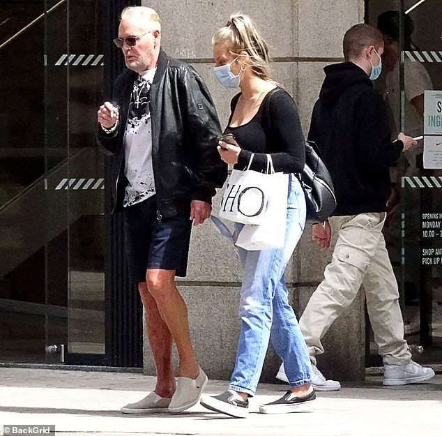 Catch-up: The star kept things casual in a leather bomber jacket and shorts while manager Katie also cut a low-key figure in jeans and a black top