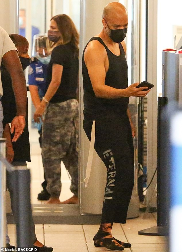 Staying casual: The actress and her beau both wore black shirts and baggy pants as they exited the travel center