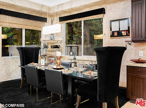 Comfy: Living spaces such as the dining area and living room with fireplace offer copious windows and lots of light