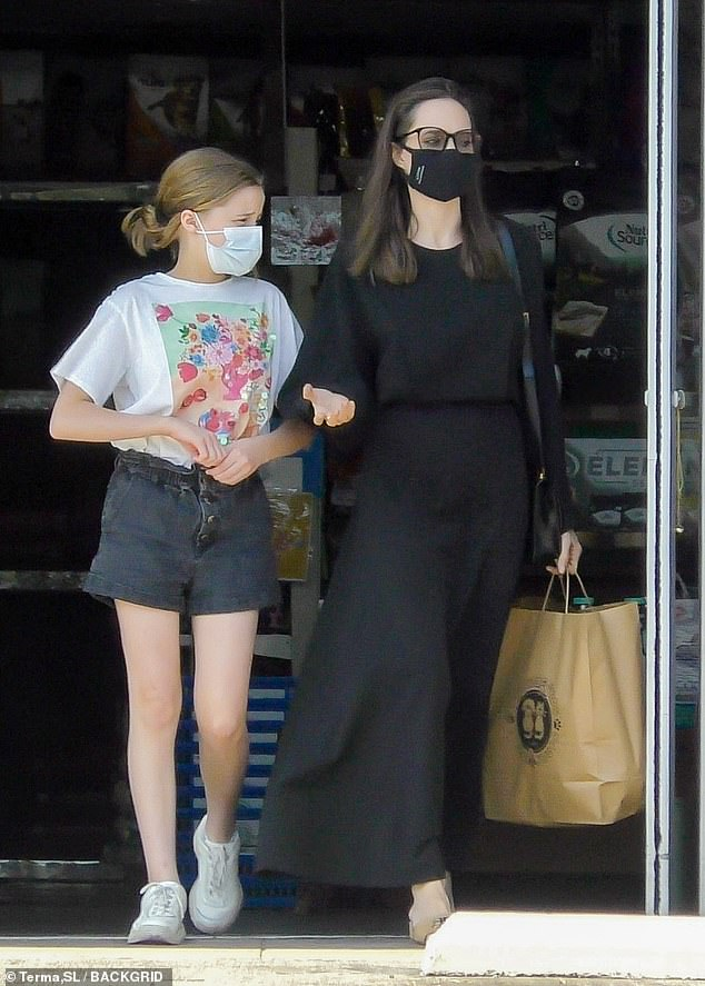 Simply chic:Despite the laid-back occasion, Angelina exuded sophistication in a chic black dress with beige sandal heels