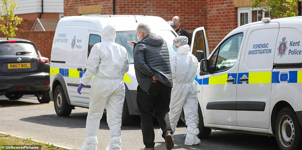 Forensic teams on the scene inAylesham are pictured during their searches of the house. It comes after they arrested s suspect last night