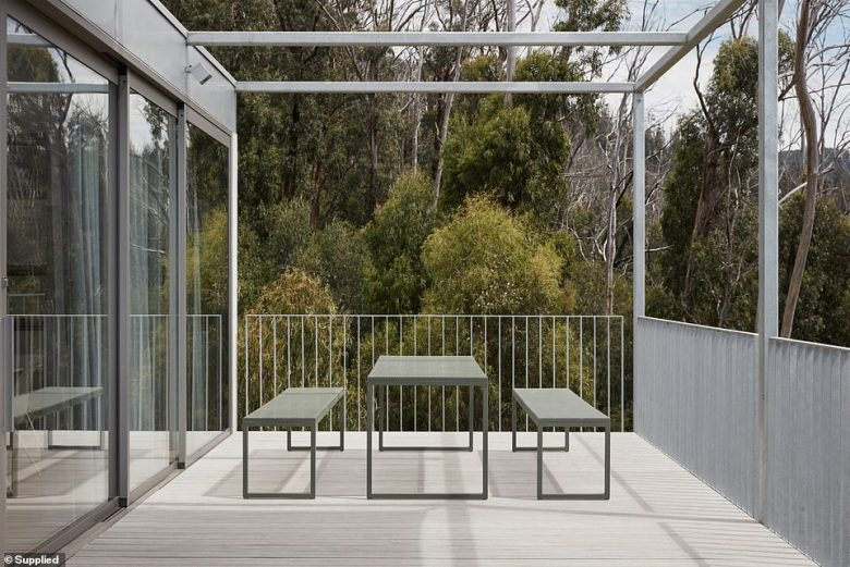 The outside deck area with a balcony overlooking the stunning landscape