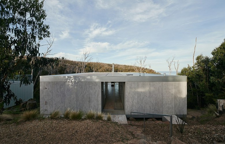 A striking property named Cumulus House is made from galvanised steel has been built and inspired by its bushfire-ravaged surroundings in Victoria near the Great Ocean Road
