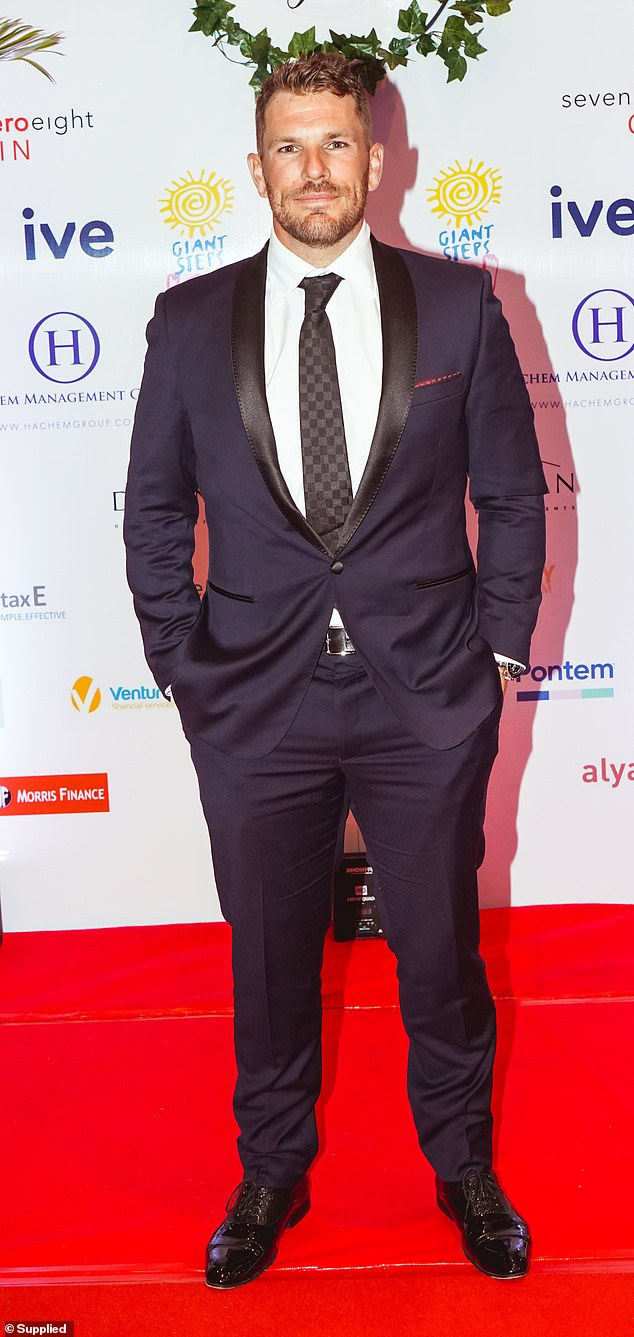 Hunky:Cricketer Aaron Finch flaunted his muscular chest in a tailored blue shit. He paired the suit with a Louis Vuitton tie and a pair of lace-up dress shoes