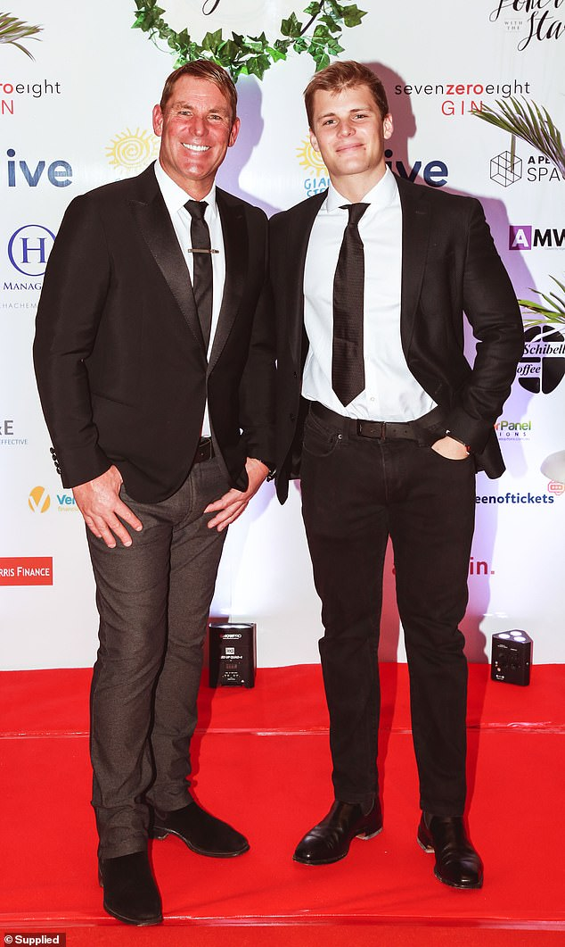 Duo: Shane was joined on the red carpet by his lookalike son Jackson (R)
