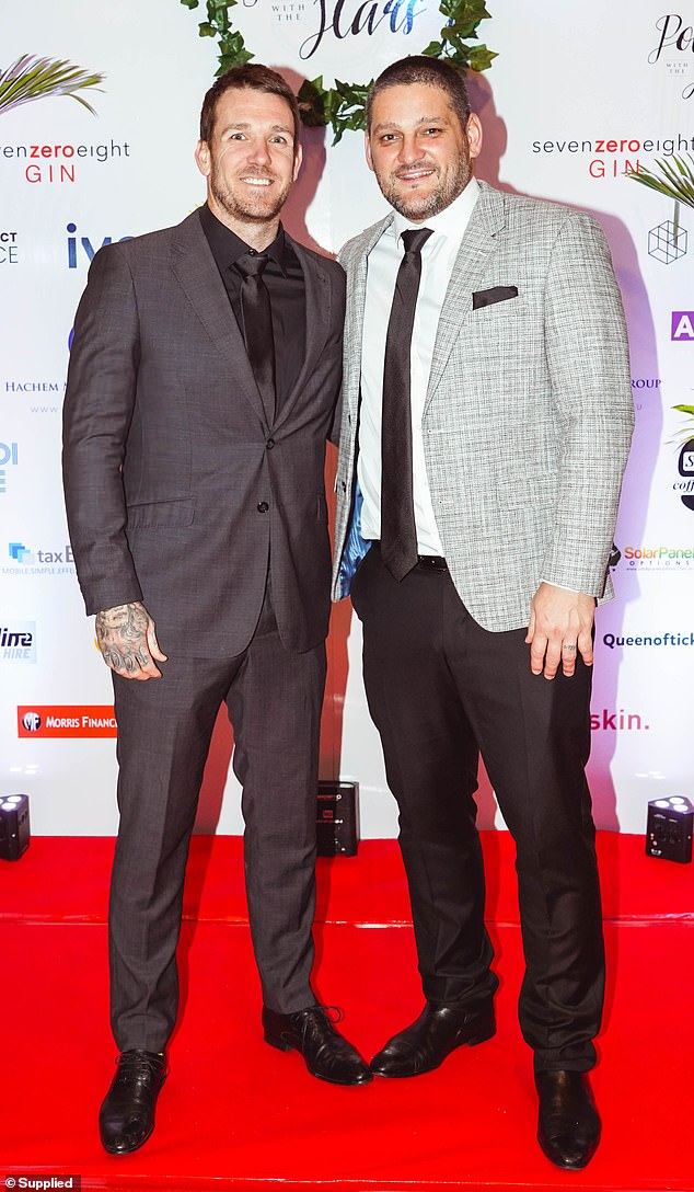Dapper gents:Dane Swan (L) cut stylish figure alongside Brendan Fevola (R) as the two men posed together.The former AFL stars looked worlds away from their time on the football field