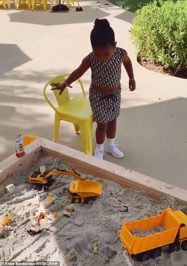 Doting mom: The reality television personality's first video showed her daughter True hanging out in front of a toy-filled sandbox